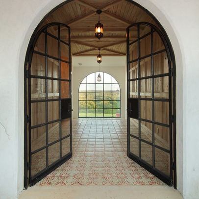 Steel doors, love the wood ceiling, patterned tile floor.