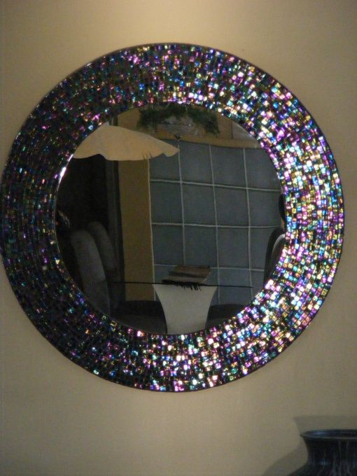 "Iridescent Mosaic Mirror, This lustrous mirror incorporates a rich, iridescent tile produced by treating glass with premium metal oxides. The tile becomes part of a striking mosaic reflecting light with ever-changing effects. This mirror has black, gray, and silver undertones, and when it catches the light, it shimmers with purples, blues, silvers and golds. I used Black orchid 3/8"" glass tiles from Sicis Tile., Home Decor Project"