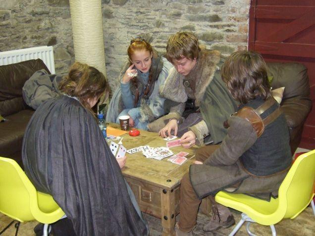 Maisie Williams (Arya Stark), Sophie Turner (Sansa Stark), Alfie Allen (Theon Greyjoy) and Isaac Hempstead-Wright (Bran Stark) playing cards...