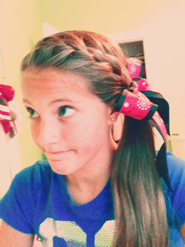 French braid all the way down into a ponytail. Add a bow and-bam- you have a cute hairstyle for school, softball, or just around the house.