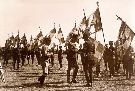 The Greek King Constantine decorating the victorious war flags outside Kütahya, 1921.