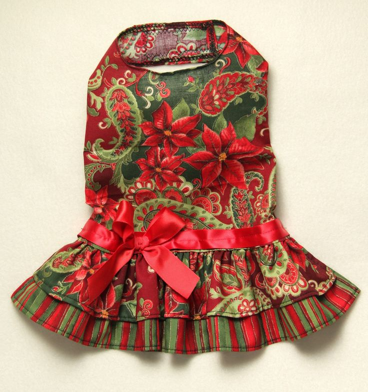 """- Beautiful Christmas Dress - Two layered coordinating skirt - Red ribbon and bow at waist - It easily attaches with adjustable velcro neck and belly straps - Open chest design XXXS fits 7 - 9"""" chest"""