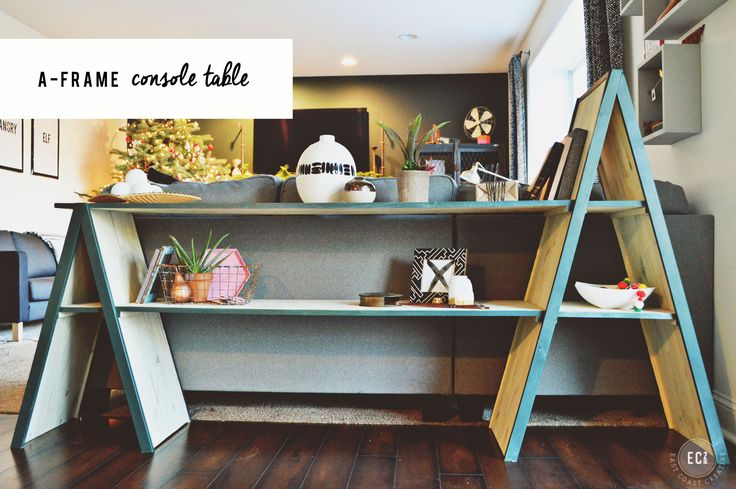 Simple tutorial to build a modern, A-frame Bookshelf or console table. I made one for my house and one for a retail store. Click through for the tutorial