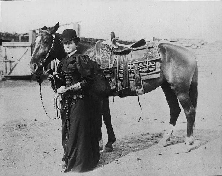 Real Texas Cowgirl ... in bowler hat, stylish gauntlets, and with horsehair quirt, stands beside her horse, which has a horsehair bridle and cowgirl-style, double-rigged, heavily carved sidesaddle, c. 1900  Panhandle Plains Historical Museum, Canyon, Texas