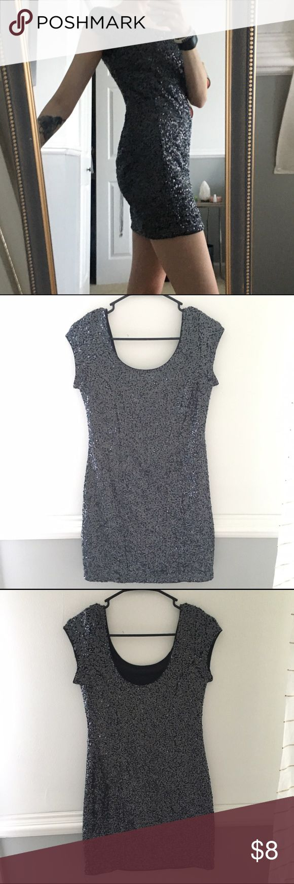 Navy Sequin Mini Party Dress -Worn Once- Fun sequin dress. Navy sequins with black lining. Lining on the inside keeps it comfortable. Great for a night out! H&M size 10, fits like a small/med, keeps its shape and stays in place throughout its wear. Divided Dresses Mini