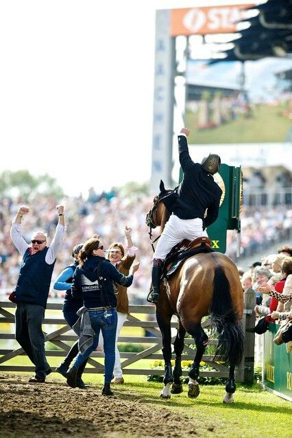 Nick Skelton & team celebrate after finding out Big Star won at Aachen.1 of 3 showjumping grandslam