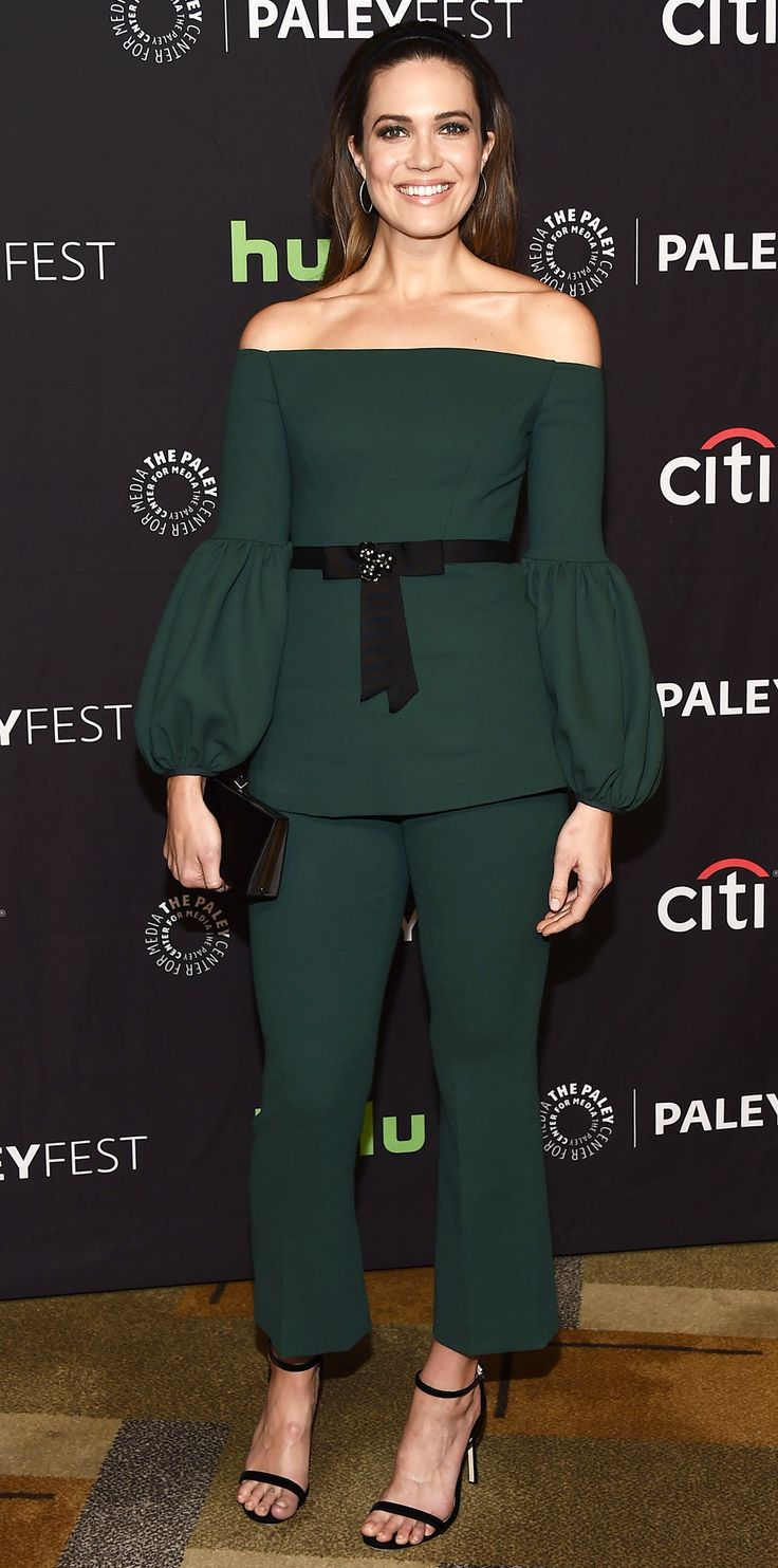 Mandy Moore had us swooning in this emerald green look. The This Is Us star wore an off-the-shoulder top with voluminous sleeves and black ribbon detailing. She paired it with matching cropped trousers and black accessories: strappy sandals and a satin clutch. Silver hoops kept the look simple and yet oh so glam.