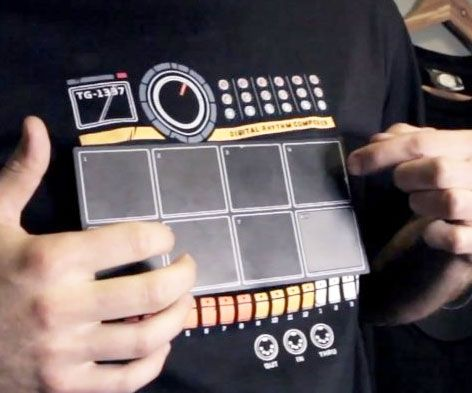 Bust out a eardrum shattering solo whenever the mood strikes with the electronic drum machine shirt. This black cotton tee features a fully functional drum machine that lets you choose from nine different drum kits, allowing you to create your own drum loops.