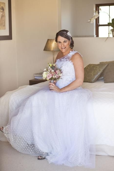 Janita Torien Wedding Dress in white with polkadot tulle skirt and one shouldered lace strap - beautiful and available at www.designerresalecapetown.com