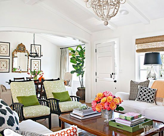 Make sure that open-concept spaces read as one cohesive whole. Lay the same type of flooring in all areas and duplicate ceiling treatments whenever possible. When it wasn't feasible to add beams to the dining room ceiling, the homeowner carried the living room's tongue-and-groove board details to the dining room ceiling. /