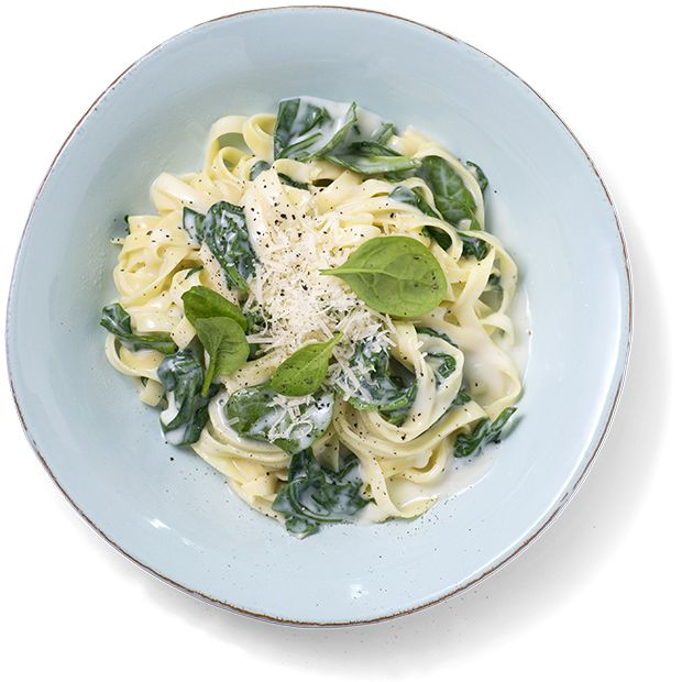 Mettende og kremet pasta med ostesaus er perfekt og rask middag. Oppskrift på tagliatelle med ostesaus og fersk spinat.