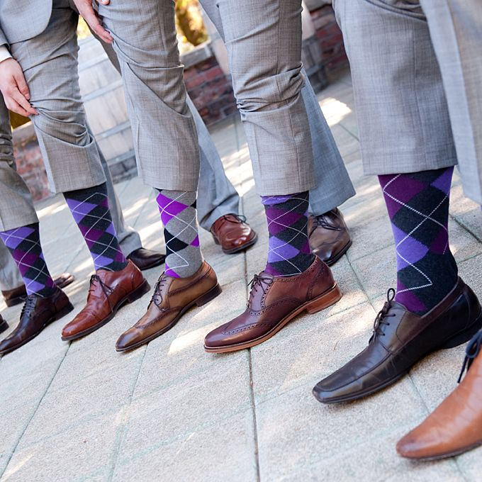 Brides.com: . Groomsmen showed a pop of color palette-appropriate color by wearing purple argyle socks from Express.