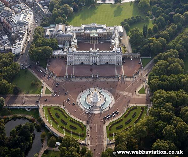 Buckingham Palace - Buckingham Palace was purchased in 1761 by George III and named The Queen's House.  Originally a grand house, remodelling began in 1762.  King George IV decided to modify Buckingham House into a palace around 1820.  The building has been remodelled many times since.