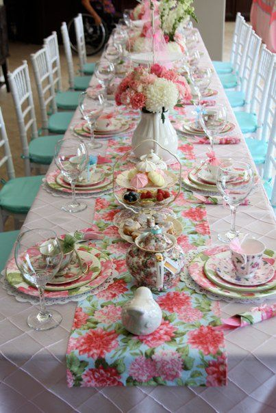 Love the idea of the fabric runner down the center of the table...could be any chintz  print...so pretty