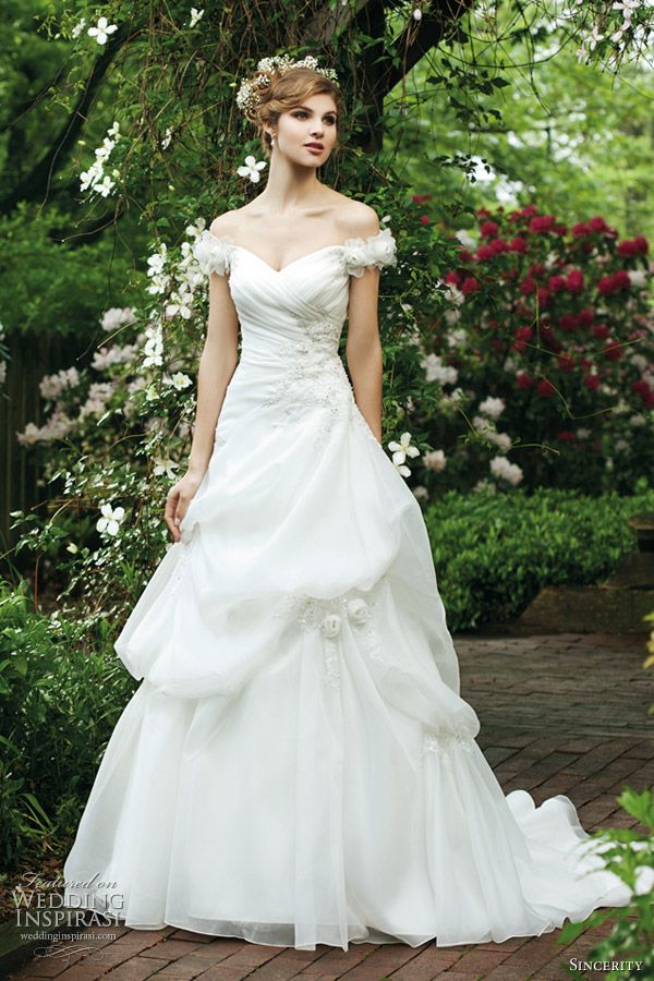 Sincerity Bridal Wedding Dresses 2012  Off the shoulder gown with lace and flowers, beaded appliques and organza pick up skirt.