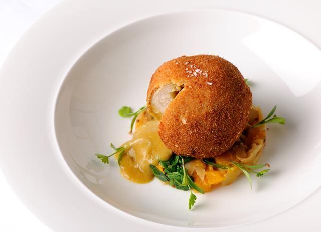 Curried chicken Kiev with squash sag aloo