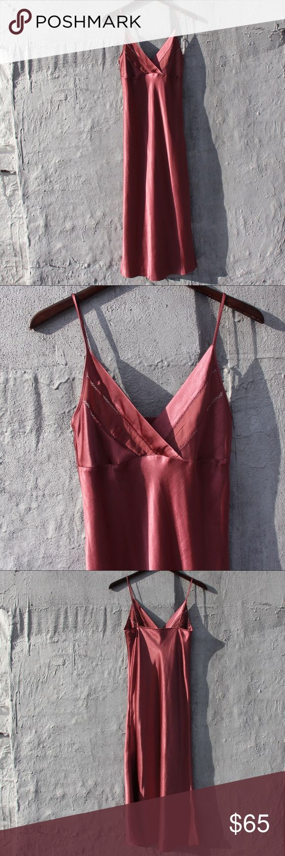 Silky cami dress Deep rose gold cami dress. I don't know the material. It's a lot thicker than silk giving great coverage. ***check out my Instagram @brieharding to see my closet in motion. Everything in my closet has been curated with love and I rock it myself! Dresses Midi