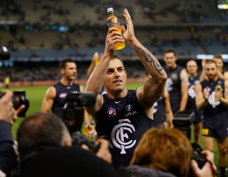 Celebrating his 250th game and winning the 2013 AFL Round 8 match against Port Adelaide at Etihad Stadium.