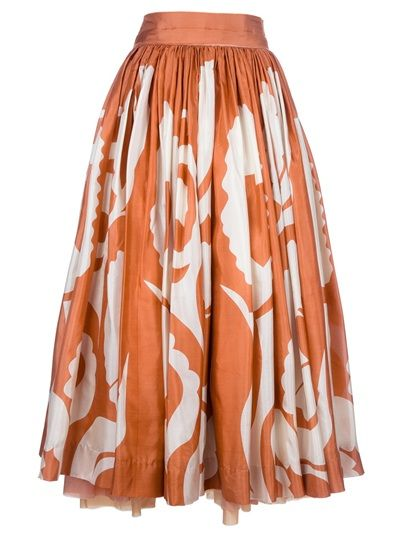 Orange silk-cotton blend skirt from Felicity Brown featuring a cream abstract print, a wide fitted waistband in contrast cream to the black, a concealed fastening to the back, a flared full skirt, a layered tonal pleated underlay and a layered hem.