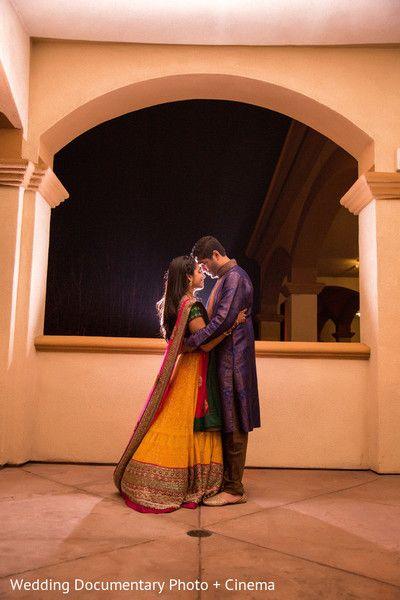 Indian wedding photography. Couple photo shoot ideas. Indian bride wearing bridal lehenga and jewelry. #IndianBridalHairstyle #IndianBridalMakeup Groom wearing #Sherwani