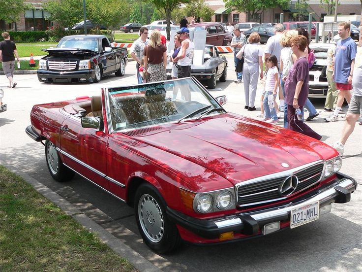 In my secret life... I drive a 1988 Mercedes 560 SL Red Convertible.
