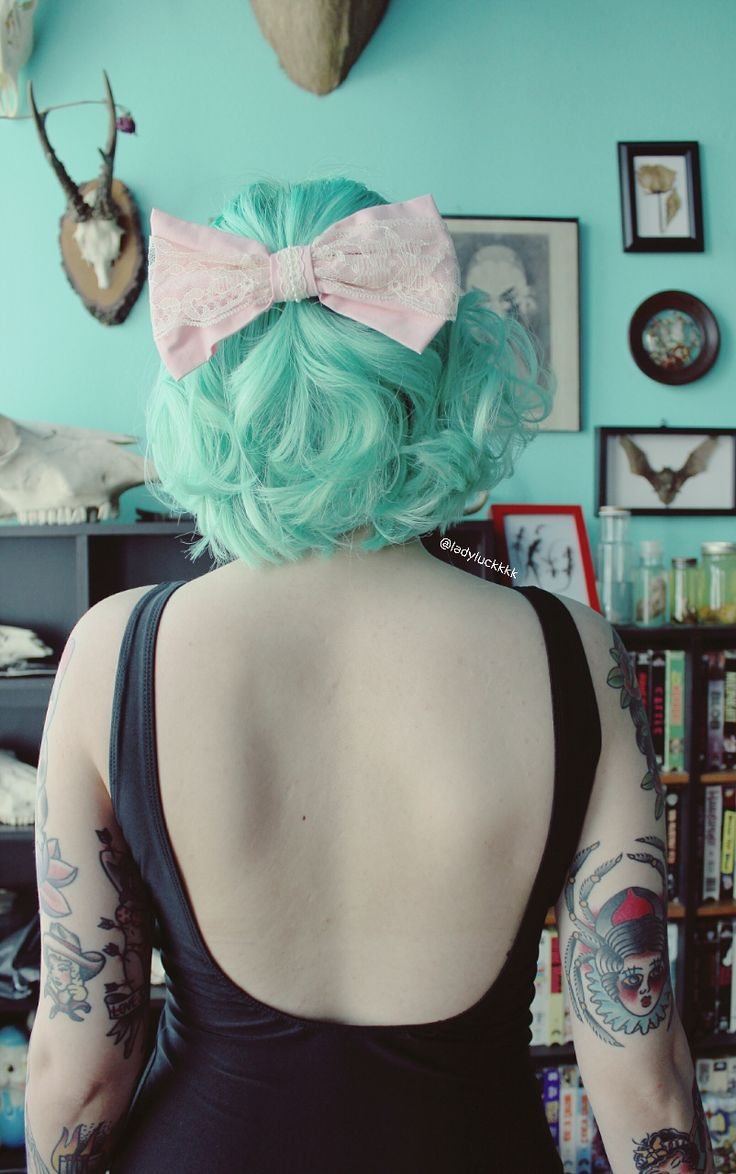 pastel mint hair and a bow More hair inspiration at: www.hairchalk.co…