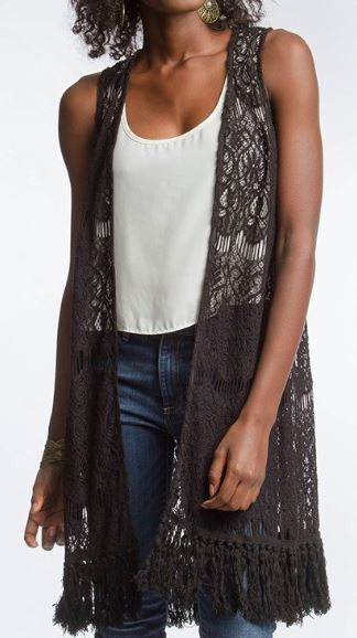 Black lace fest with beautiful detail and fringe bottom 65% cotton, 35% polyester Stylist Note: We are obsessed with this effortless piece! The perfect, trendy addition to your wardrobe. Easy to dress