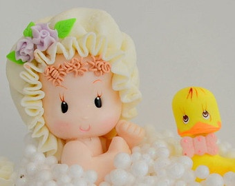 Baby girl and rubber ducky in a tub cake topper
