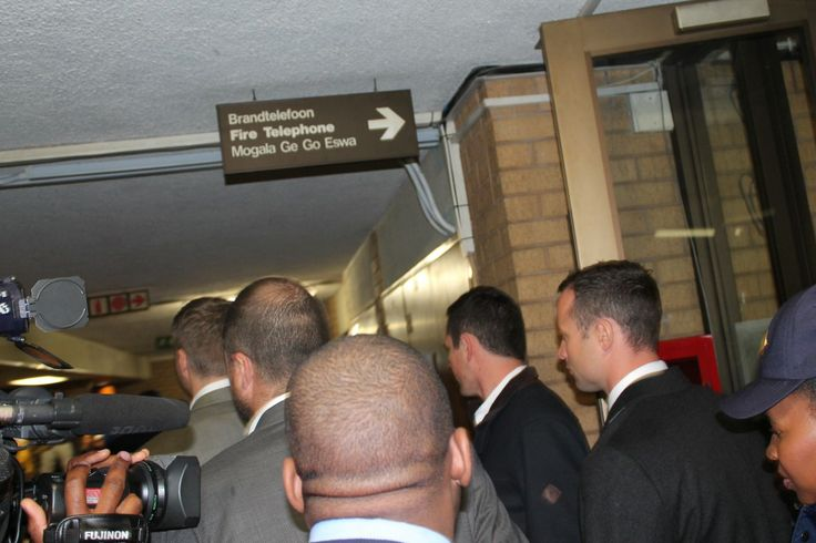 Oscar Pistorius and his team making their way to the court room.
