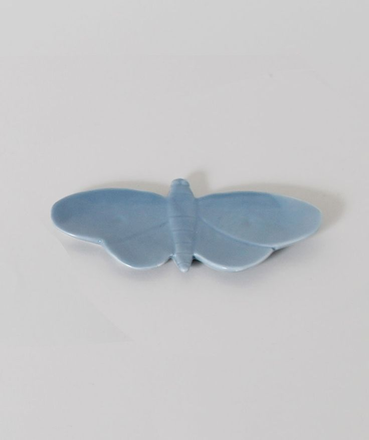 Display your trinkets on this sweet porcelain moth trinket dish. | huntingforgeorge.com