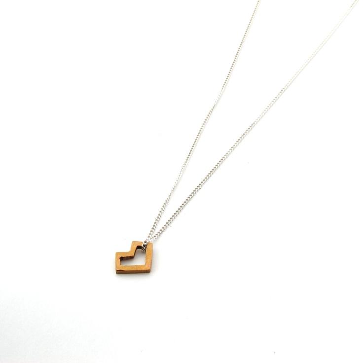 Small heart pendant - Geometric bronze heart on silver chain. $31.00, via Etsy.