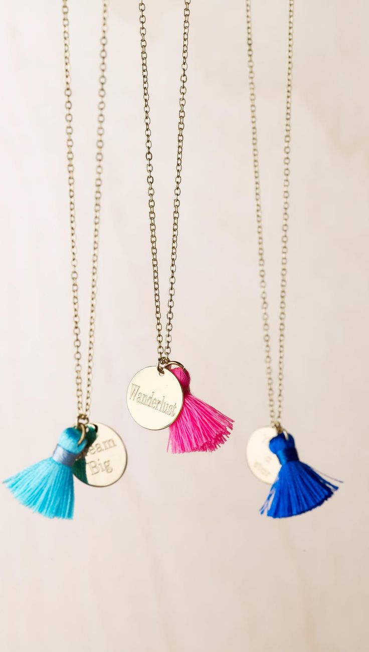 Add a personal message to this gold-plated round charm featuring a playful pink tassel, to create a unique necklace.
