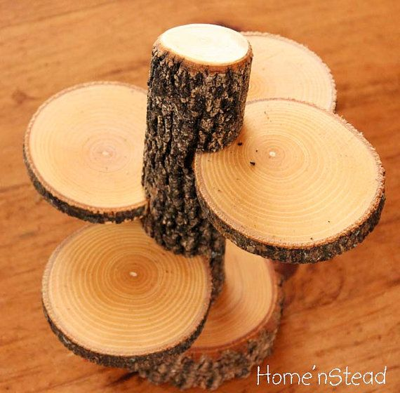 Rustic cupcake or display stand from branch and log slices.