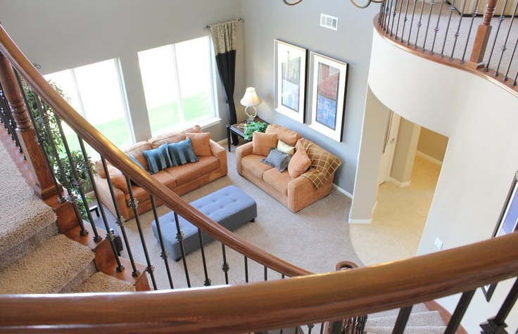 High Ceilings And Soft Colors Make This Pulte Living Room