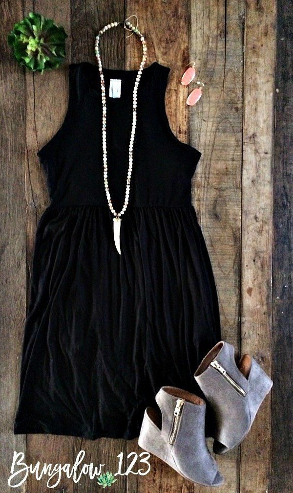 Perfect casual little black dress. Sleeveless with racerback and slight empire w…