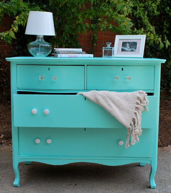 I totally want to find an old dresser on Craigslist for free and redo it in this color :)  My goal when we get a house is to have a room full of the many different Tiffany Blue ideas I have on Pinterest :)  Hey, a girl can dream!! ;)
