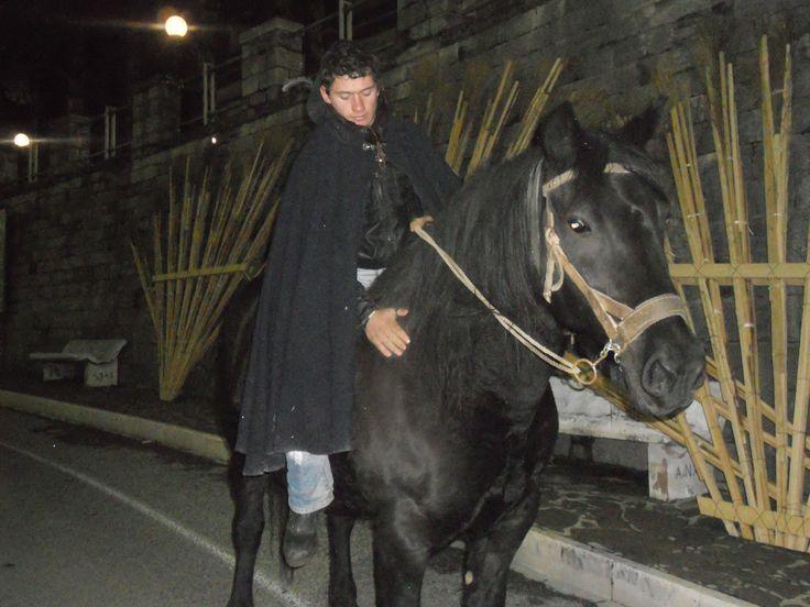 Un 'portatore' a cavallo