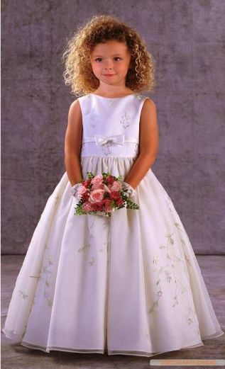 """Keep your flower girls looking like little girls.  Don't cave in to letting them wear make up or dresses that are too old for them.  They'll feel like """"Princesses"""" even in modest dresses and little girl hairstyles.  Be sure to practice in order to calm her nerves.  It may be wise to have two, as it's easier to be brave with a friend.  Dress by:http://www.cocodresses.com"""