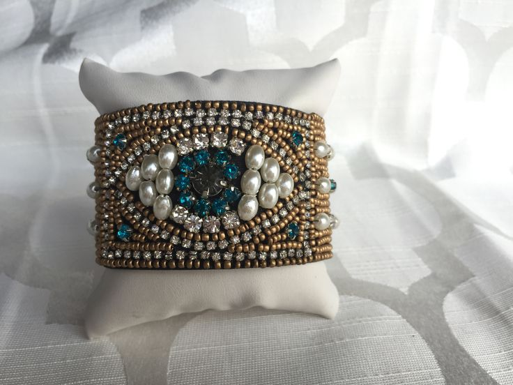 Get your glam on with Mika collection pearl and rhinestones cuff. More Info: Before making a purchase, please be sure to read our return policy.                                                                                                                                                                                 More