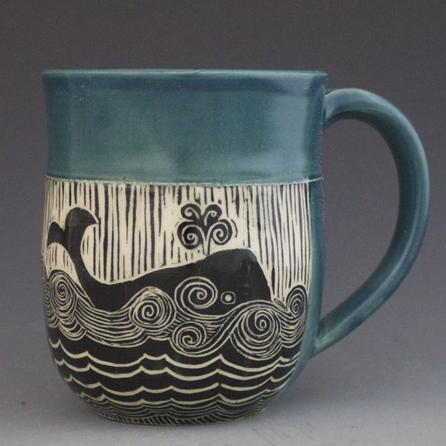 Handmade pottery mug with whale etched in a woodcut-style design by Patricia Griffin. Mug for beach house!