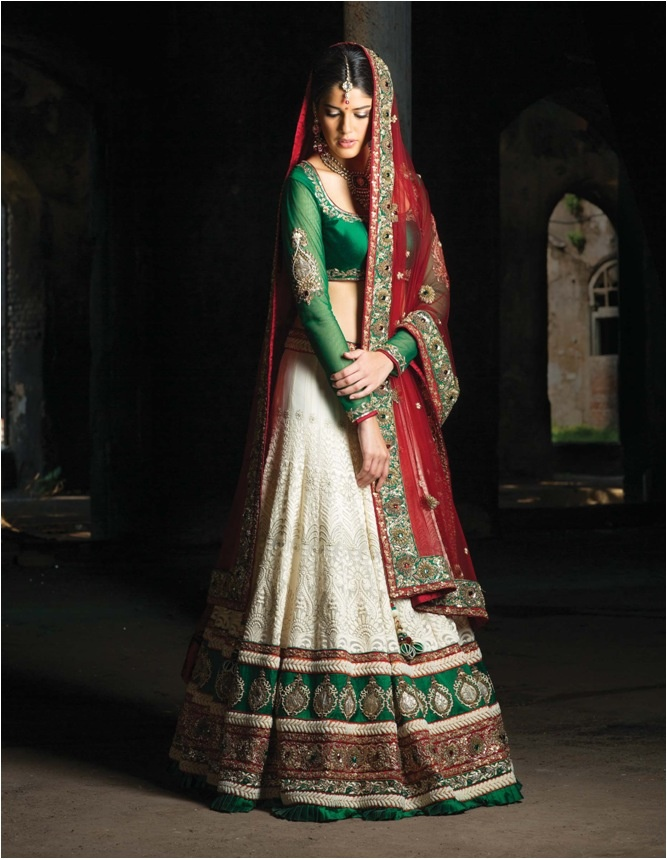 Benzer red,green and white wedding lengha. I particularly love the log sheer sleeves with the one piece of ornate work on the arm!!!