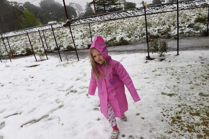 Georgia Delahunty from Brisbane gets her first taste of snow at Blackheath after up to 20cm snow fell on the Blue Mountains.