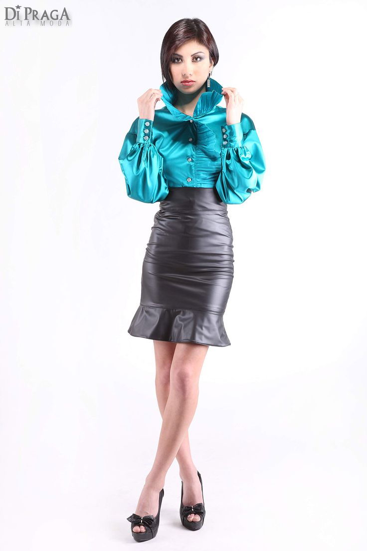Great combo of aqua green satin blouse and black leather peplum skirt.