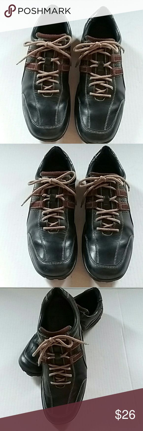 Cole Haan Mens BLK/BRN LEATHER lace oxford shoes This is a pair of Cole Haan black with brown stripe leather Oxford lace up shoes. They are size 9.5. They have Vibram soles and are an excellent preowned condition. Cole Haan Shoes Oxfords & Derbys