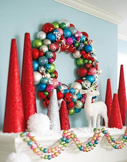 For a sparkling mantel to match the wreath, coat foam cones with spray-on glue then tinsel glitter. More holiday mantel decorating ideas: http://www.midwestliving.com/homes/seasonal-decorating/holiday-ideas/christmas-mantel-decorating-ideas/?page=7,0: