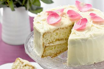 White chocolate cake recipe - goodtoknow------with white chocolate grated into it and rose water infused white chocolate frosting.  YUM