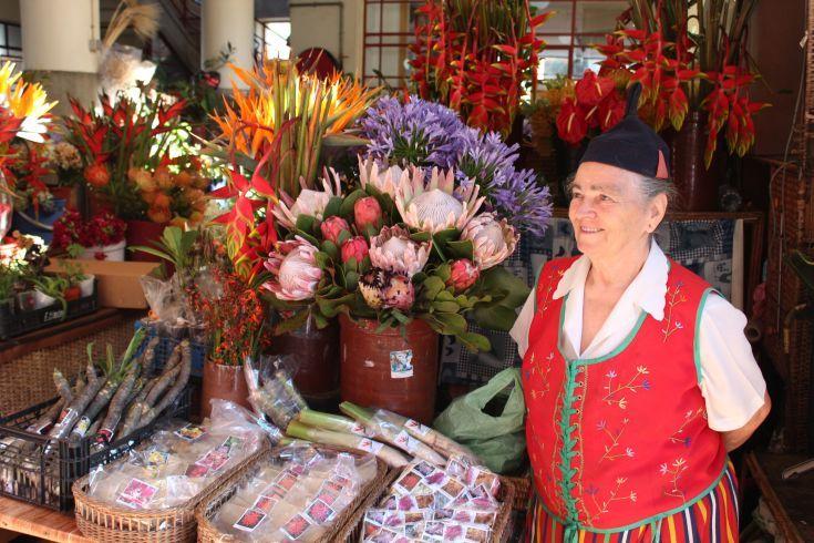 Madeira, Funchal - a flower seller in the Mercado Lavradores.