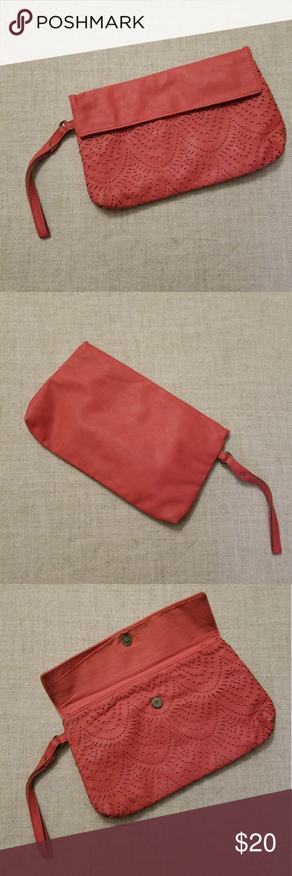 American Eagle Outfitters wristlet/ clutch purse. American Eagle Outfitters wristlet/ clutch purse in a coral color. Bohemian cut out detail on front, button closure, excellent used condition. American Eagle Outfitters Bags Clutches & Wristlets