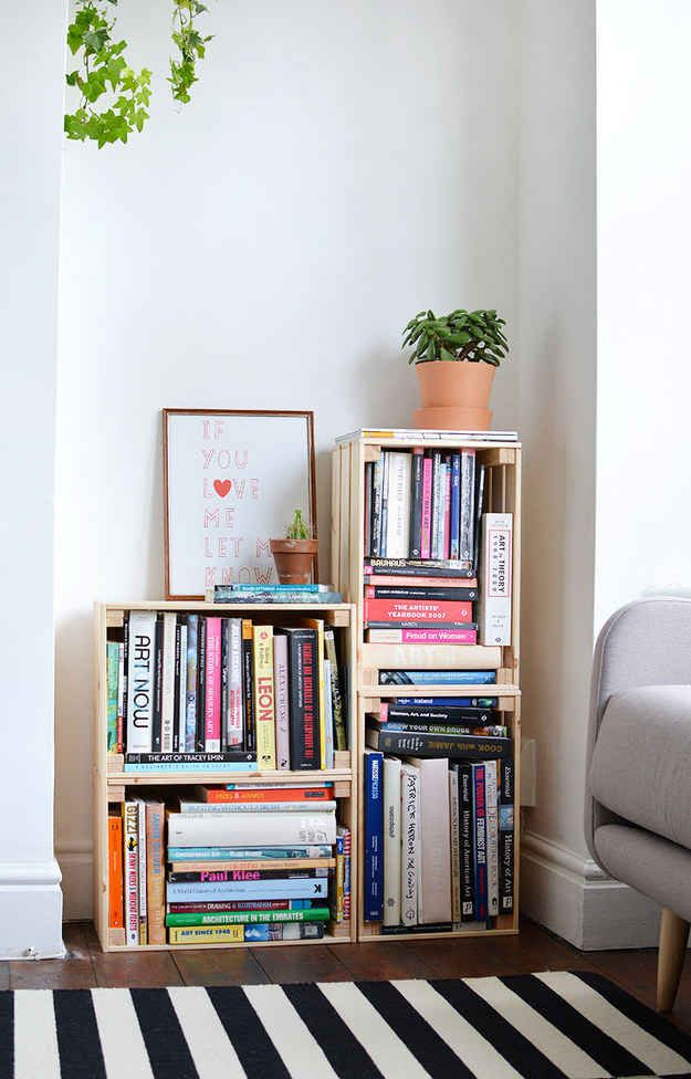 Stack up some cheap crates to make a custom bookshelf: