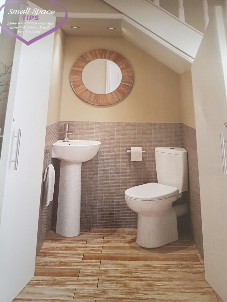 downstairs under stairs toilet idea i like how the doors open and it has a
